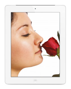 Image of an iPad showing an image of a young woman smelling a rose